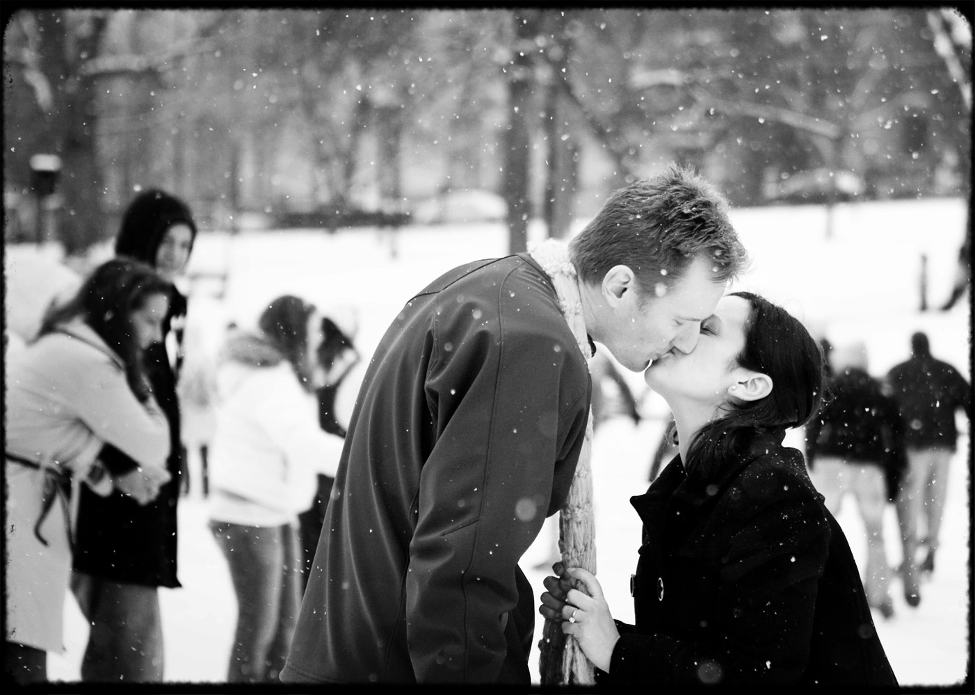frog_pond_engagement_boston_ice_skating_kiss
