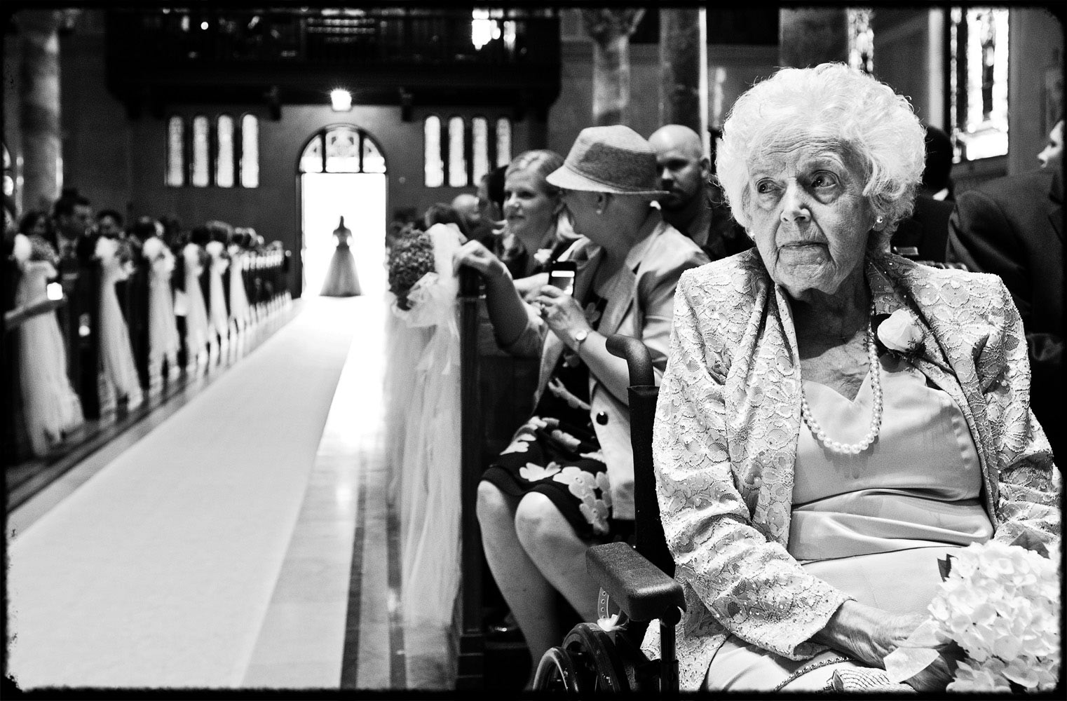 grandmother watches bride walk herself up the aisle
