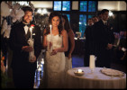 bride and groom circling with candles and corwns during greek wedding ceremony