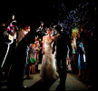 bride and groom exit wedding with bubbles at night