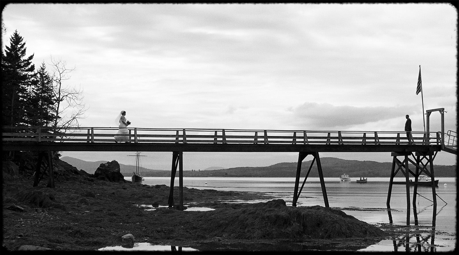 black and white first look on pier in maine wedding