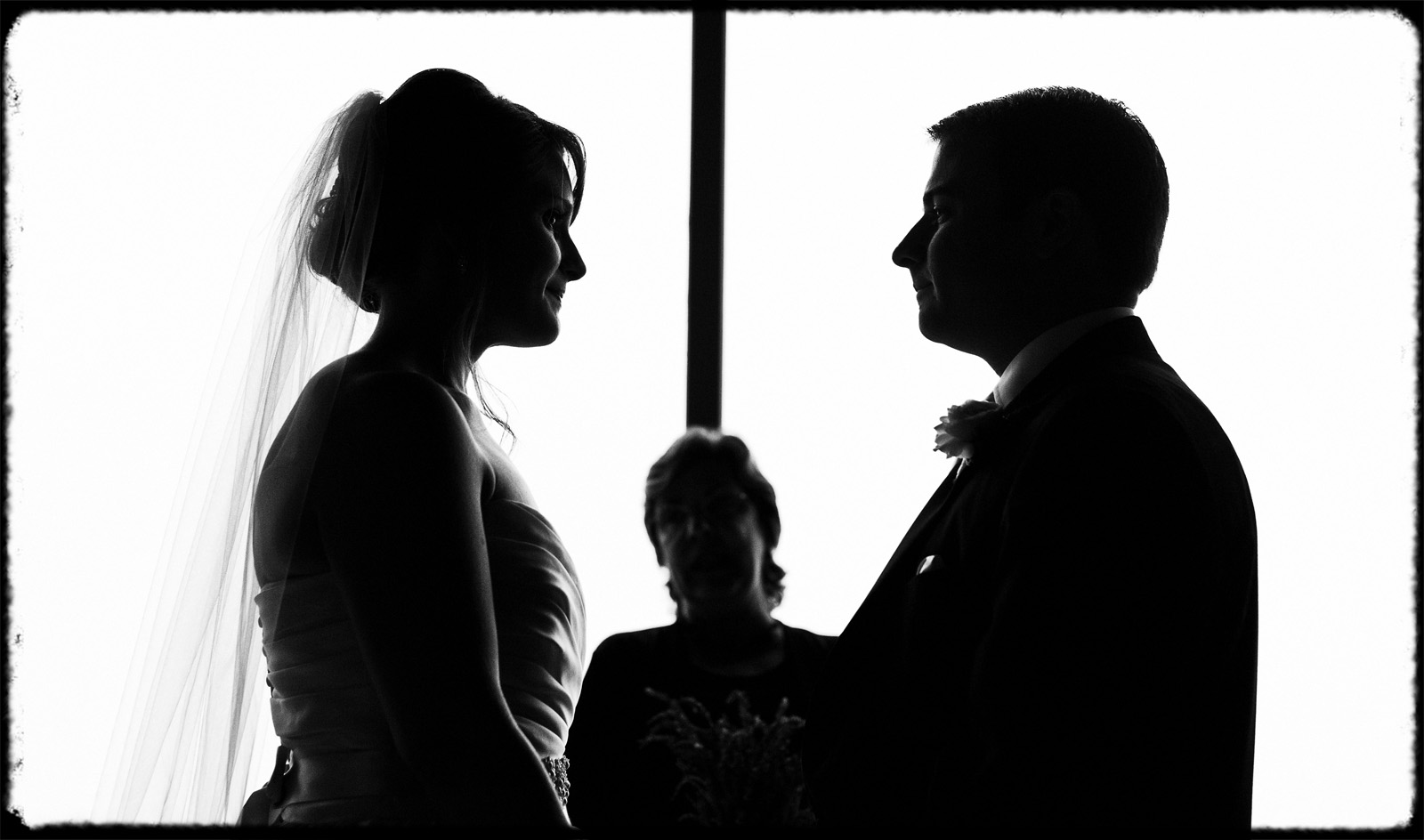silouette couple exchanging wedding vows