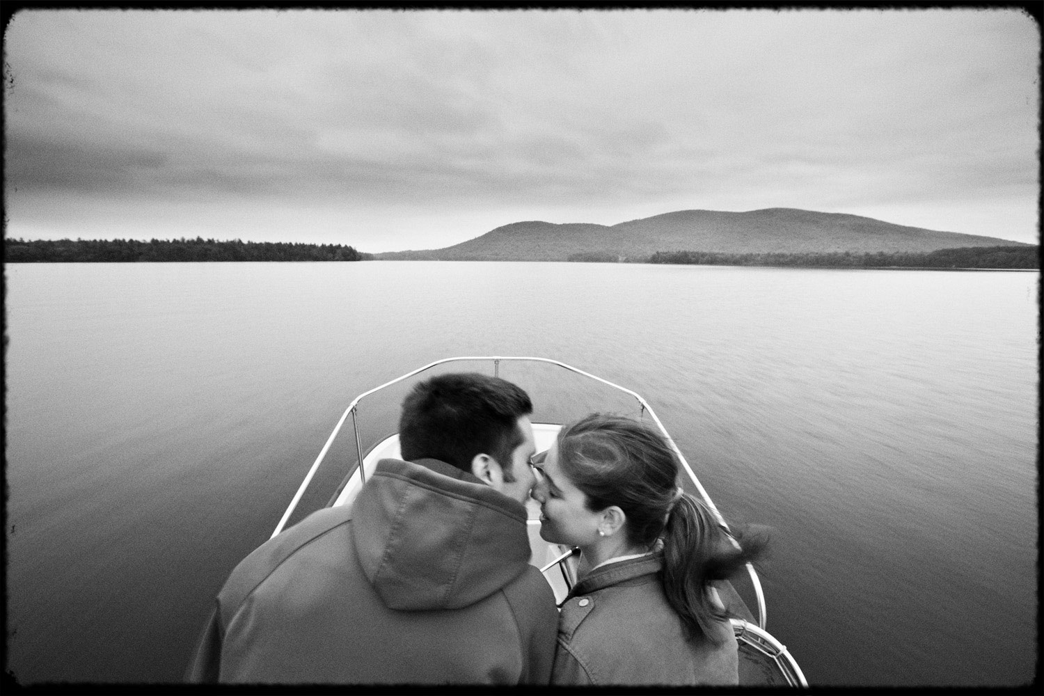 squam_lake_engagement_boat_kiss