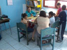 Patricia Ortega, the Mata Ortiz librarian and a member of Proyecto Cervantes, helping children learn to read.