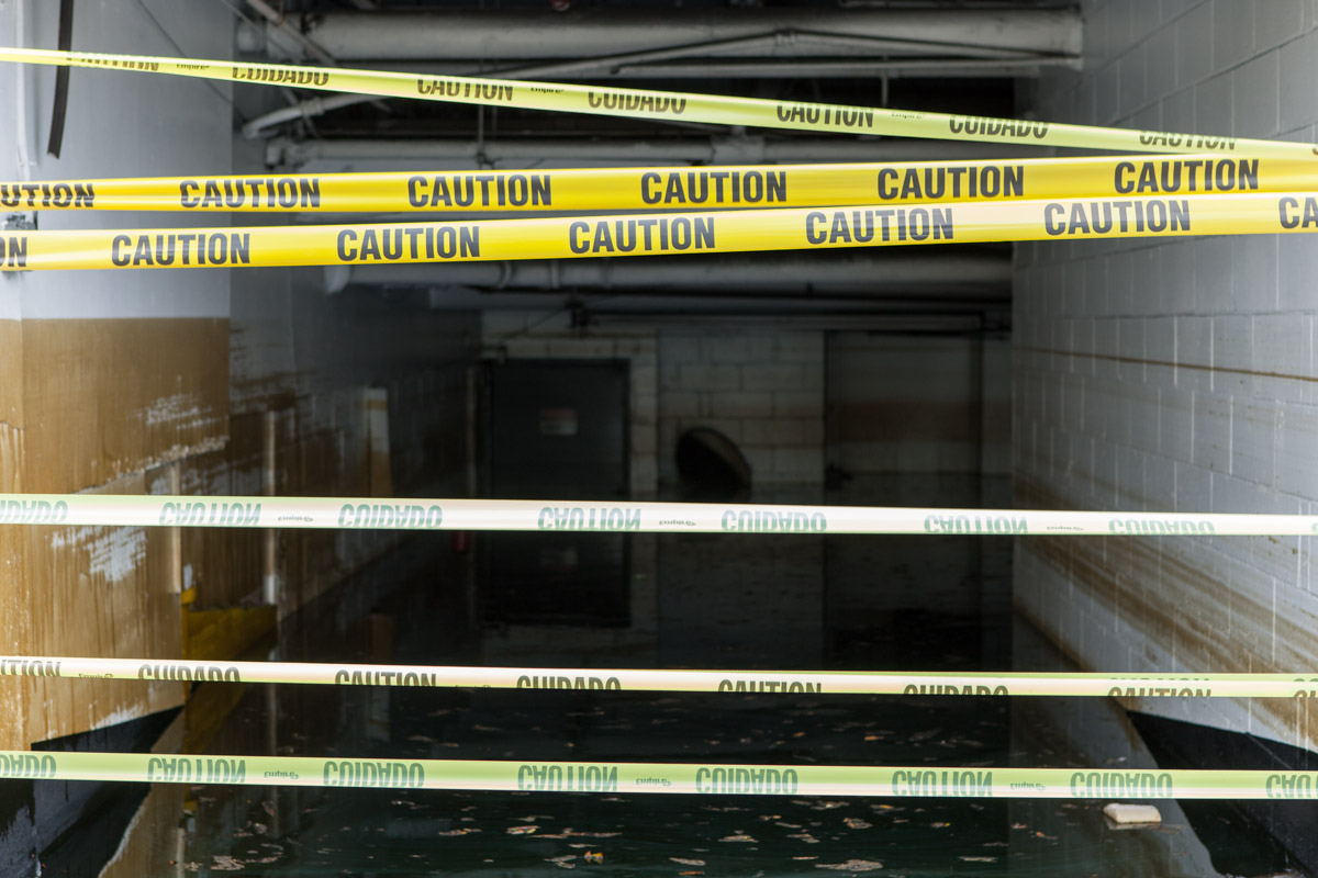 Caution tape blocks entrance to a flooded parking garage on West Street following Hurricane Sandy. October 30, 2012.