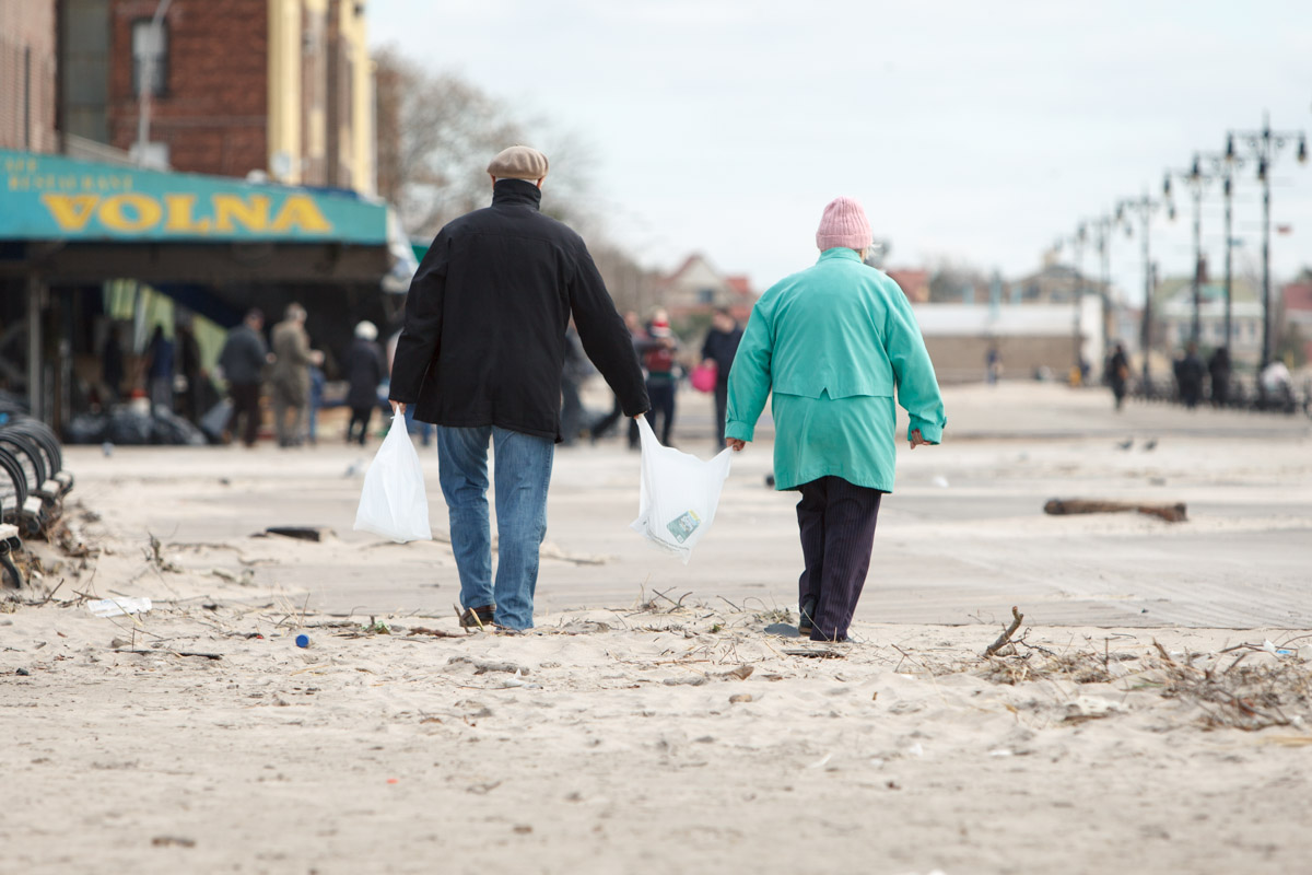An elderly couple returns to  Brighton Beach carrying water in the wake of Hurricane Sandy. November 1, 2012.