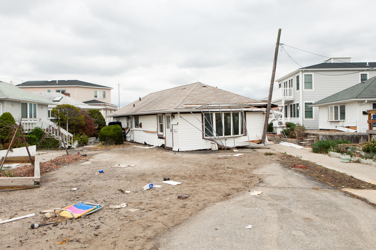 A house is torn from its foundation and now sits in the middle of a street in Breezy Point, Queens, following Hurricane Sandy. November 1, 2012.