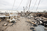 Downed power lines amidst the one hundred and eleven homes destroyed by fire in Breezy Point, Queens during Hurricane Sandy. November 1, 2012.