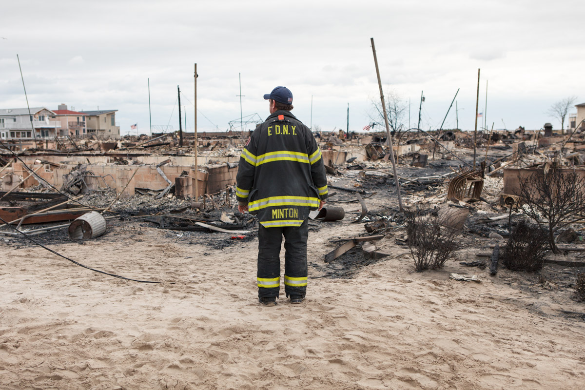 A fireman surveys the damage in Breezy Point, Queens following the fire that destroyed one hundred and eleven homes during Hurricane Sandy. November 1, 2012.