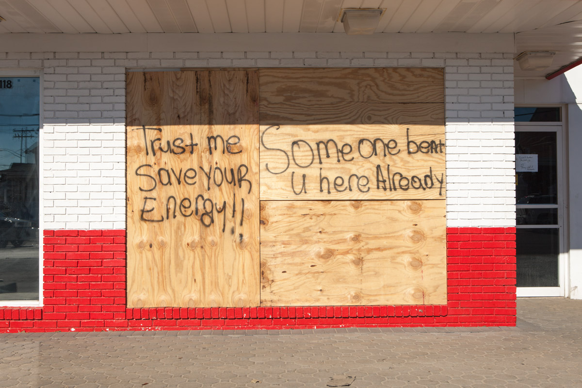 Message to potential looters on a boarded-up McDonald's in Rockaway, Queens, in the wake of Hurricane Sandy. November 4, 2012. Beach Channel Drive at B 91st.