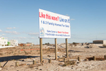 A sign advertising new condos for sale survives Hurricane Sandy, Rockaway, Queens. November 4, 2012.