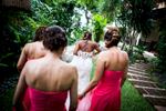 A young bride and her bridesmaids walk through a luxury resort in Koh Samui, Thailand, on the way to the wedding ceremony.