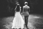A blurry image of a recently married bride and groom.