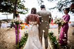A bride is walked down the isle by one of her best friends at a beautiful beach wedding in Koh Samui, Thailand.