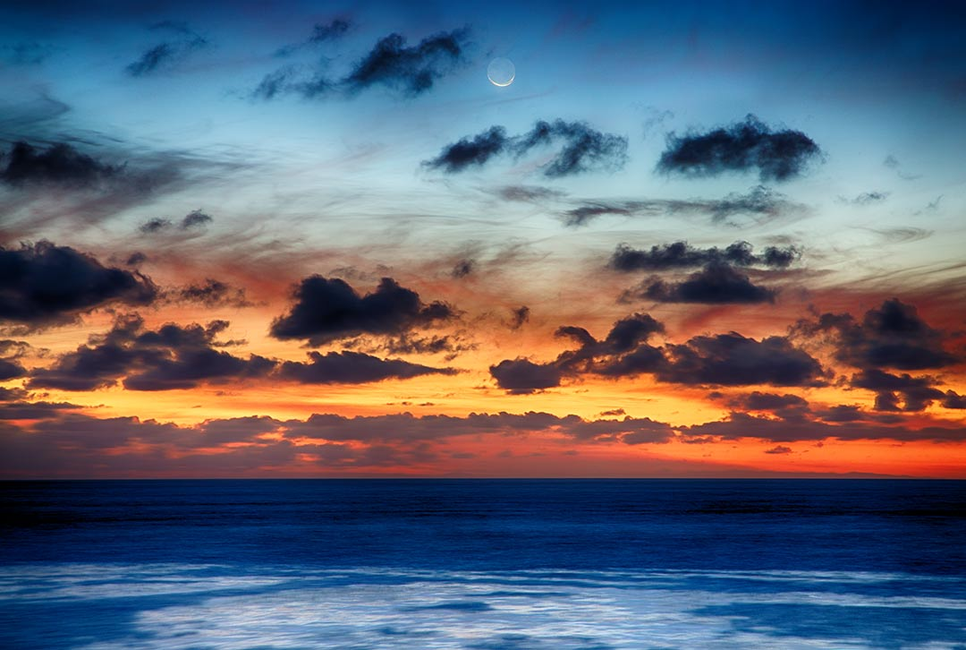 On the first day of the Chinese New Year, {quote}Year of the Horse{quote} I witnessed the sunset and moonrise at the same time. Beacon's Beach, Encinitas, California