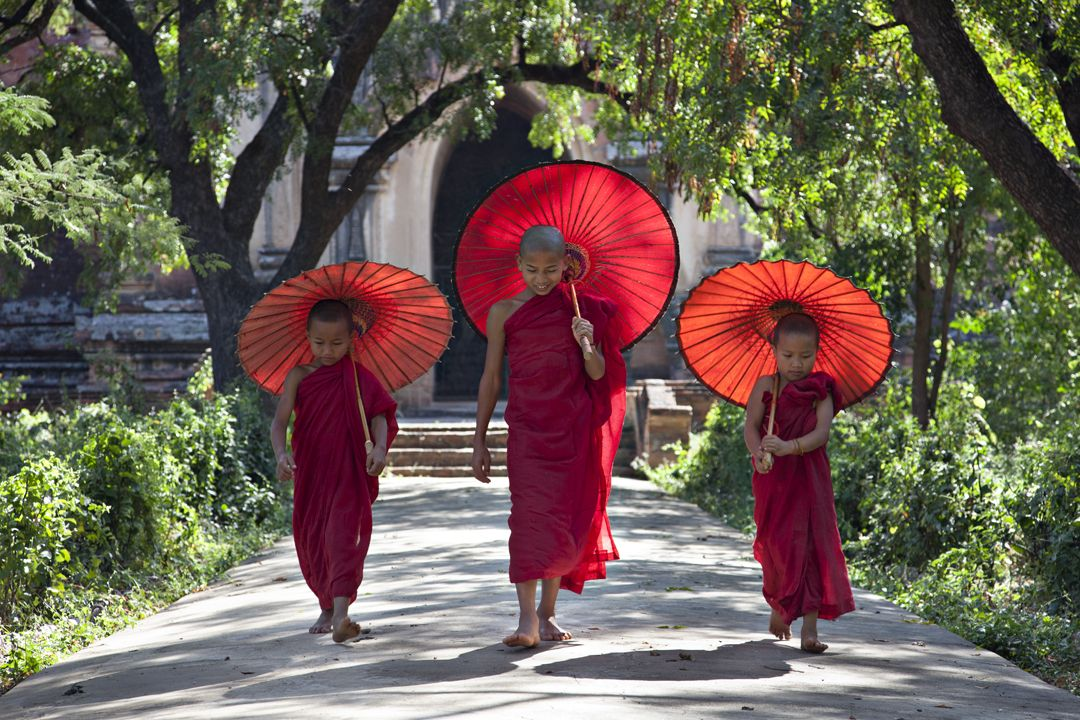 Three young monks walking out of the 12th century Sulamani Temple.Minnanthu - Bagan, Burma