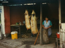 This roadside market just sells pigs. I shot this in the morning and came back at dusk to see that most of the meat had been sold. Quito - Ecuador