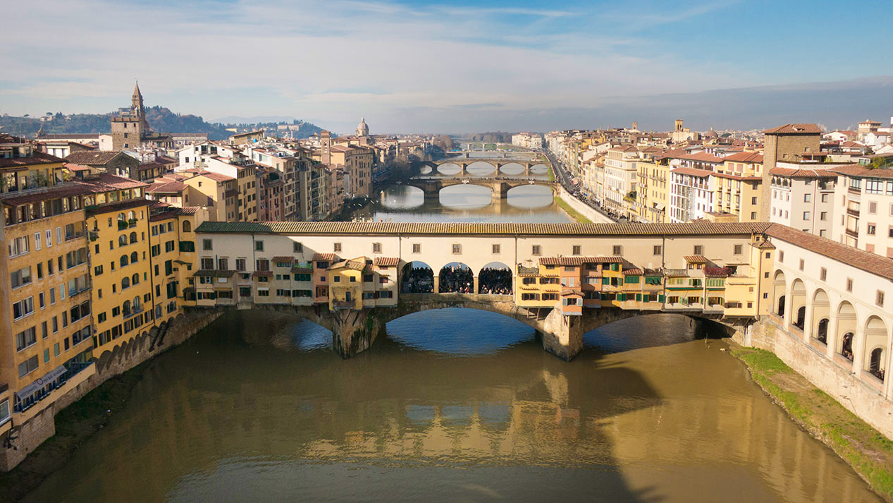 The Ponte Vecchio is a Medieval stone closed-spandrel segmental arch bridge over the Arno River, in Florence, Italy