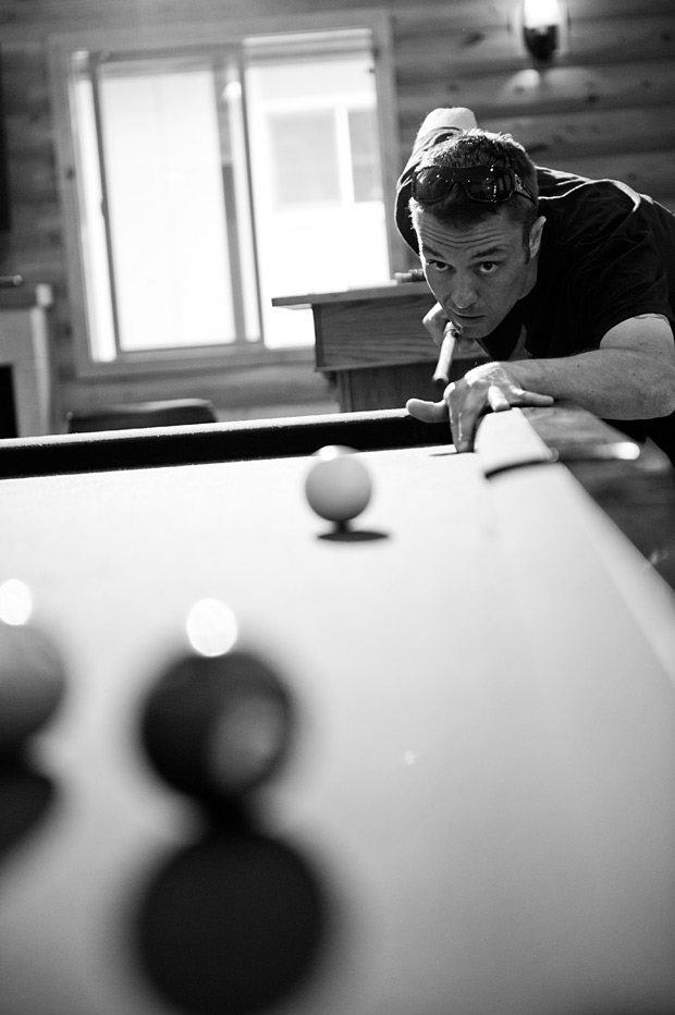 groom playing pool.
