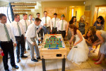 bridal party playing fusbol.