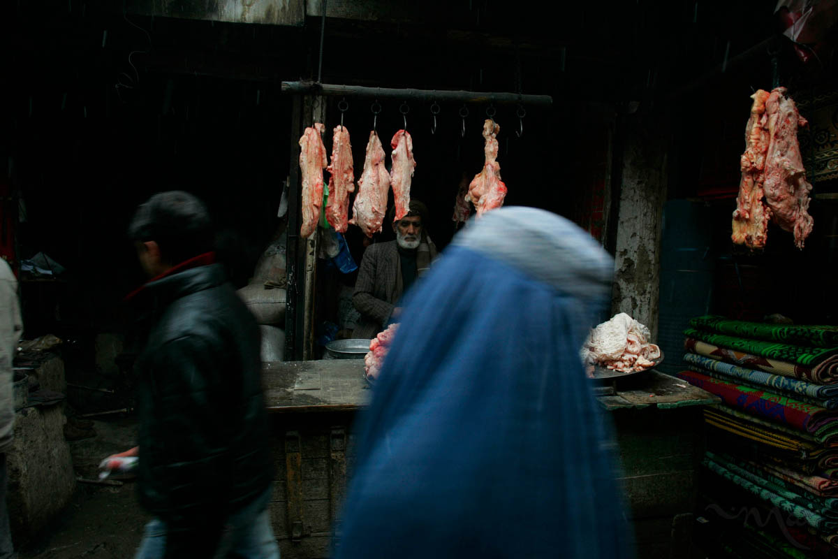 As a slow snow falls, a Kabul butcher waits for customers in the cavernous Mandai Market. Even as international troops, aid and money flooded into Afghanistan after 2001 little has changed for much of the population.