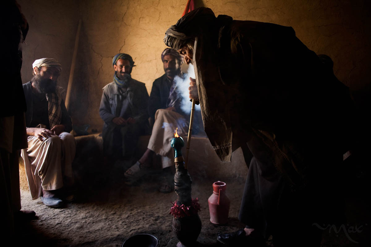 Afghan men gather at a small room in the ruins of ancient Bactra, thought to be inhabited as early as 500 B.C. to smoke hash from a water pipe. The region has successfully been pacified from growing poppy due to a directive by the governor but is known as a hub of hemp growing.