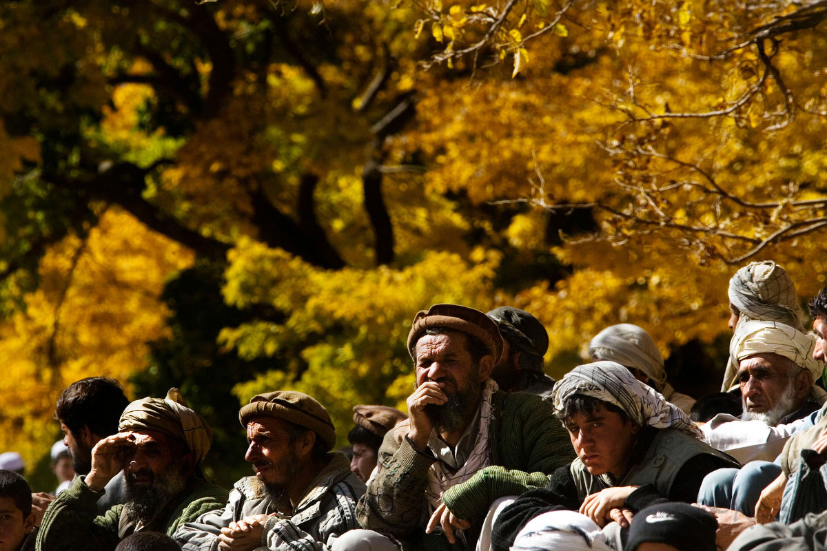 The men of Khenj, Afghanistan, watch a game of buzkashi on Friday, October 26, 2007.
