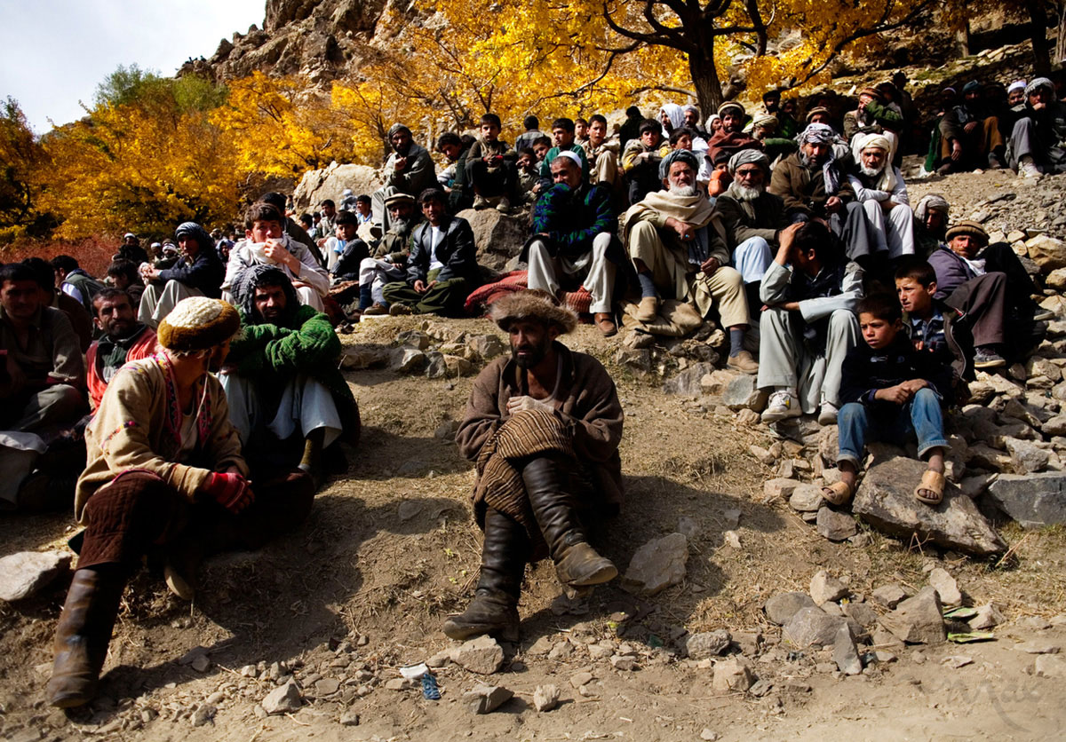 A horseman of Khenj, Afghanistan, waits to compete in a game of buzkashi dressed in heavy clothing to protect him from the violence of the game and a hat made of fur. The popular game, banned under the Taliban, is a match between villagers on horseback pitted against each other to grab the carcass of a dead goat, or in this case, a dead calf, with its head cut off, and then bring it from one location in the playing field, around a flag and set it in a circle in another location.