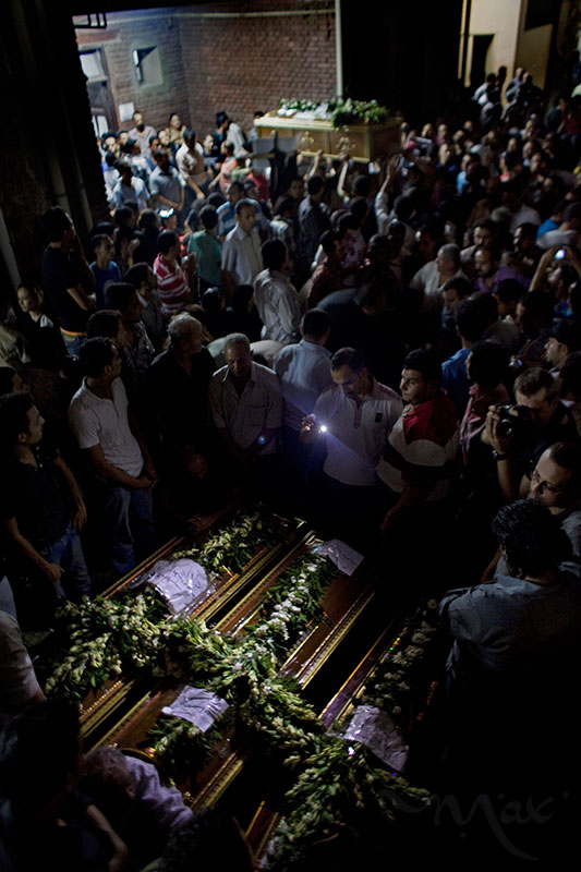 CAIRO, EGYPT. Coptic Christian Egyptians mourn more than a dozen killed during clashes with the Egyptian army late Sunday as the bodies are collected in coffins at the Coptic Hospital in Cairo, Egypt. The victims were killed during clashes at a protest by Coptic Christians demanding better protection and accountability for several church burnings this year.