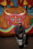 NEW ORLEANS, LOUISIANA. Mardi Gras master float painter Raymond J. Bowie poses for a photo in front of a float he has painted at Kern Studios in New Orleans, Saturday, Jan. 16, 2016. Bowie has been painting Mardi Gras floats for nearly forty years. (AP Photo/Max Becherer)