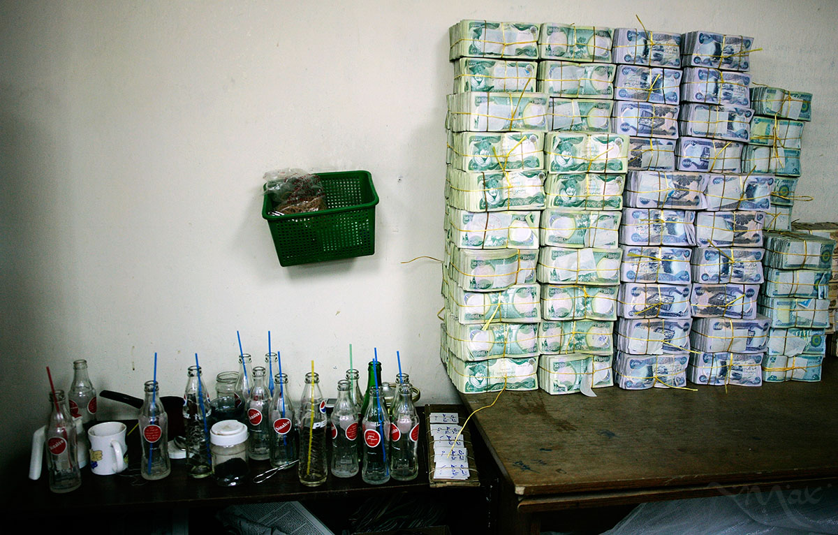 Empty Coke bottles sit on a break table next to a table of Iraqi dinars in the bank vault at the Iraq Middle East Investment Bank on Monday July 10, 2006. The rate of inflation in Iraq was recorded at 3.60 percent in 2012. That's progress compared to the all-time high of 17.2 percent reached in August of 2006.