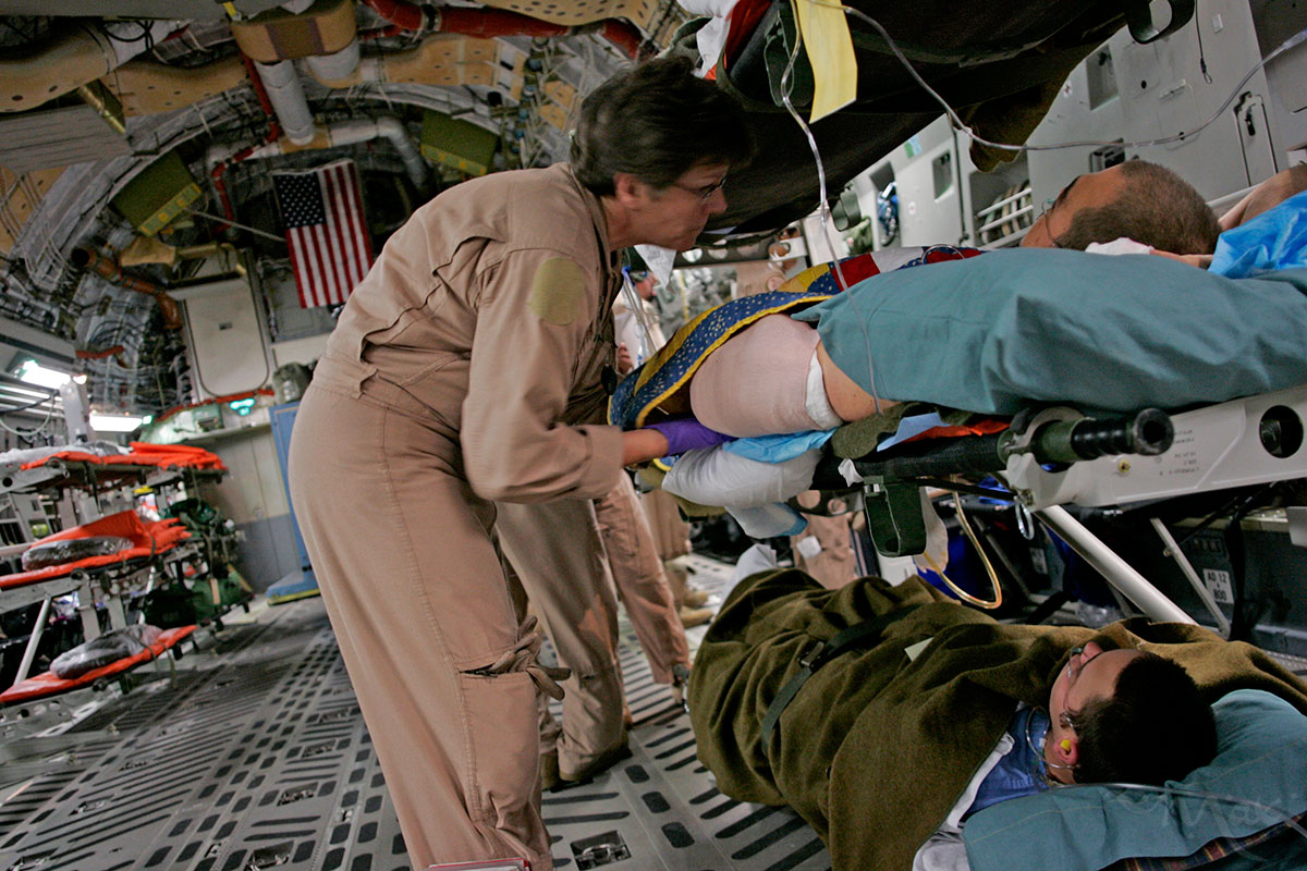 A member of the Air Evacuation Unit checks on wounded American soldiers being transported from the Air Force Theater Hospital in Iraq to the Landstuhl Regional Medical Center in Germany. Thanks to the rapidity of the transport from the battlefield to the hospital, soldiers have a 96% chance of survival from their wounds once they make it to the hospital.