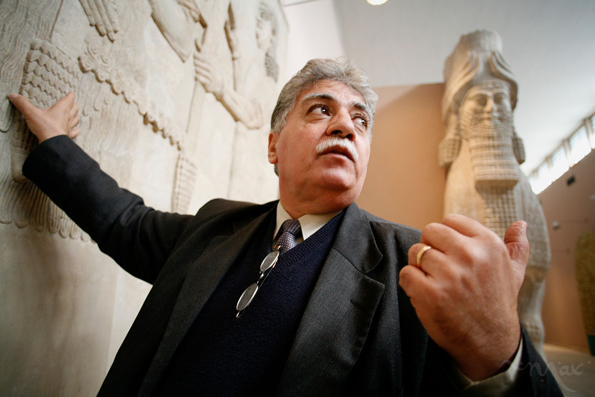 Dr. Donny George looks at Assyrian reliefs on display at the Baghdad Museum. George, the director general of Iraqi Museums, is leading the rebuilding and recovery efforts of Iraq's museums, which were looted following the 2003 U.S. invasion of Iraq. Some 15,000 objects were stolen from April 10-12 during the days following arrival of U.S. troops to Baghdad. Nine thousand of those objects have been returned or recovered. Many of the museum's objects are in museums all over the world including the U.S., Italy, Jordan, Germany and Syria. The museum has seen extensive rebuilding thanks to funds from the U.S. State Department. George is also overseeing efforts to cultivate Iraq's some 12,500 archeological sites. Donny George died on March 11, 2011.