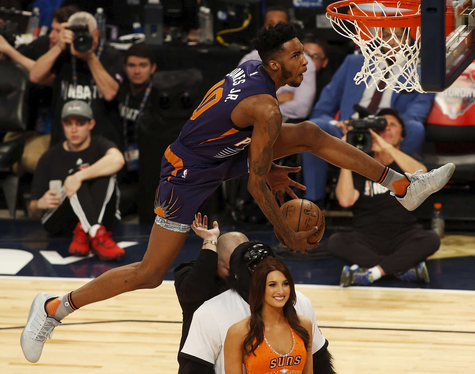 Phoenix Suns forward Derrick Jones Jr. (10) leaps over three people during the slam-dunk contest as part of the NBA All-Star Saturday Night events in New Orleans, Saturday, Feb. 18, 2017. (AP Photo/Max Becherer)
