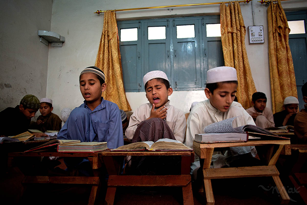 AKORA KHATTAK, PAKISTAN. Students memorize the Koran at the Darul Uloom Haqqania madrassa in Akora Khattak, Pakistan on Monday April 1, 2013. Around 3000 students study a type of ultra-orthodox interpretation of Islam known as Deobandi. Taliban leader Mullah Omar is a graduate of the school, which is regarded as a most prestigious of conservative Islamic schools.