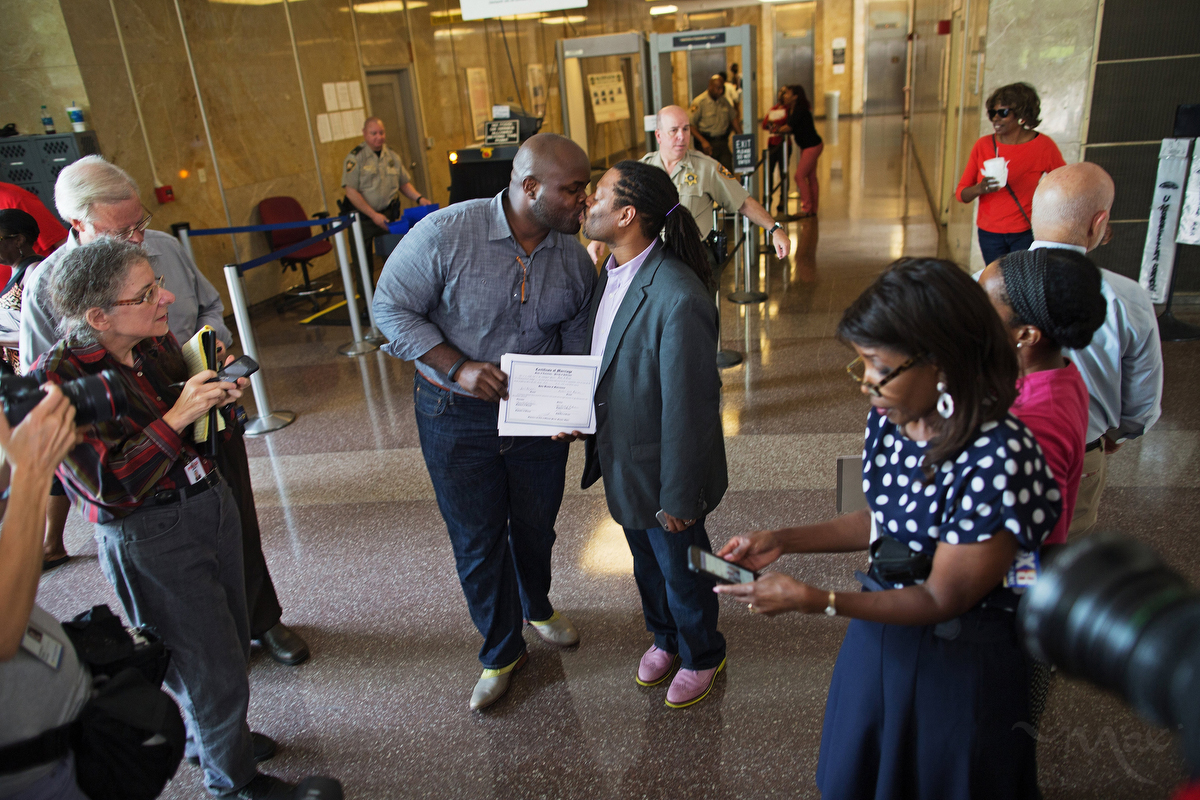 NEW ORLEANS, LOUISIANA. Earl Benjamin, left, and Michael Robinson, show their marriage certificate and kiss in the New Orleans Parish Civil District Court building after becoming the first legally gay couple to wed in New Orleans, Louisiana. Robinson and Benjamin had been together for almost 14 years before exchanging vows in the civil ceremony. (Max Becherer/Polaris)