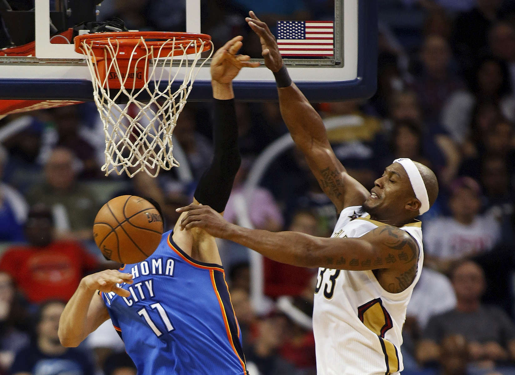New Orleans Pelicans forward Dante Cunningham, right, blocks an attempted layup by Oklahoma City Thunder center Enes Kanter (11) in the second half of an NBA basketball game in New Orleans, Wednesday, Jan. 25, 2017. The Thunder won 114-105. (AP Photo/Max Becherer)