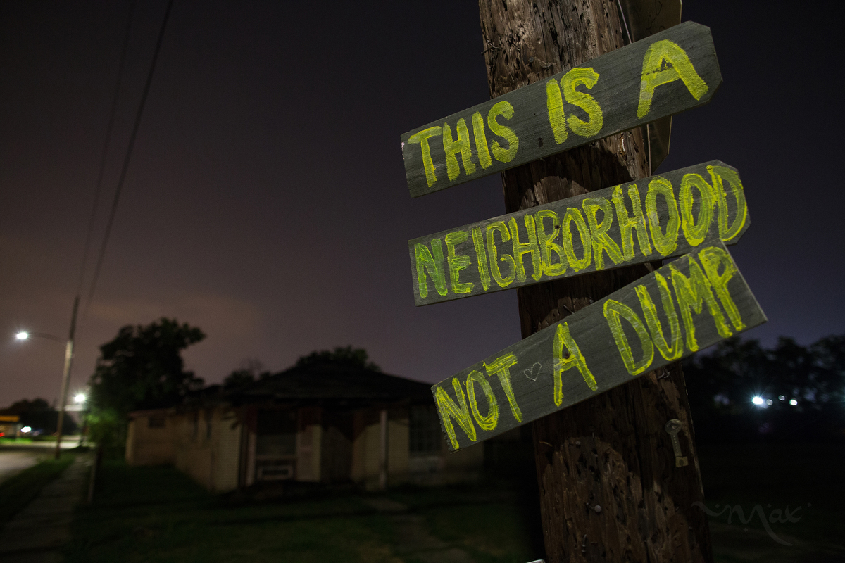 NEW ORLEANS, LOUISIANA. A hand made sign at North Rocheblave and Lamanche Streets in the Lower 9th Ward attempts to thwart the illegal dumping of tires and industrial waste in New Orleans, Friday, Aug. 14, 2015.  (AP Photo/Max Becherer)