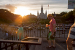 NEW ORLEANS, LOUISIANA. Beer holding visitors enjoy the setting sun on Jackson Square at the heart of the French Quarter in New Orleans, Saturday, Aug. 15, 2015. Katrina seemed like the final blow to a city long in decline, suffering from urban crime, white flight, the vagaries of the energy market and gross mismanagement. Roughly 80 percent of the city was under water. Hundreds of people drowned inside their homes, their bodies floating in the muck. Hospitals and police were overwhelmed. The city emptied.Now, as people describe the city's resurgence, they reach for metaphors that verge on the Biblical: a resurrection, an economic and cultural renaissance, a rebirth. (AP Photo/Max Becherer)
