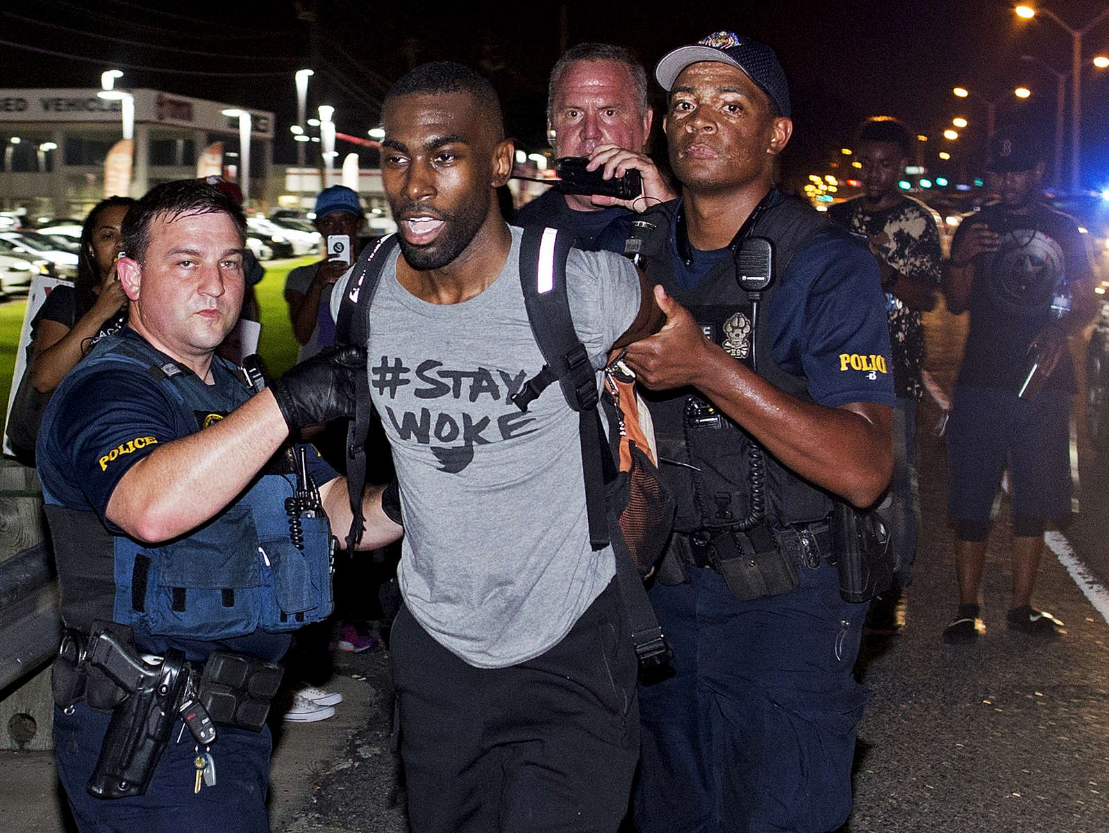 Baton Rouge police officers arrest a prominent Black Lives Matter activist, DeRay Mckesson, for allegedly obstructing a highway during a protest in support of justice for Alton Sterling in Baton Rouge, La. Saturday, July 9, 2016. Video shot by Mckesson in the moments before his arrest show him walking alongside Airline Highway on his way back to the main area where the protests were going on when he was arrested. (AP Photo/Max Becherer)