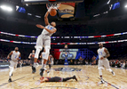 Eastern Conference small forward Giannis Antetokounmpo of the Milwaukee Bucks (34) slam dunks as Western Conference guard Stephen Curry of the Golden State Warriors (30) lies on the court during the first half of the NBA All-Star basketball game in New Orleans, Sunday, Feb. 19, 2017. (AP Photo/Max Becherer)
