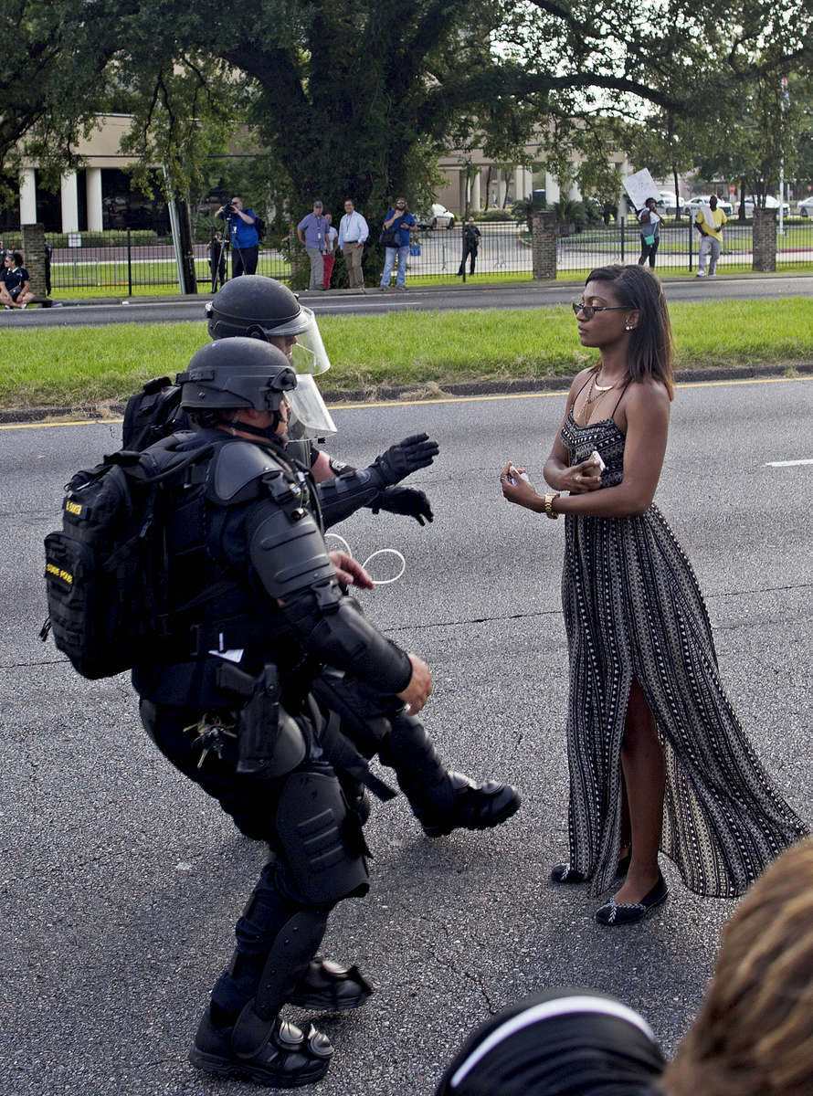 Ieshia Evans, 35, is grabbed by police officers in riot gear after she refused to leave the motor way in front of the the Baton Rouge Police Department headquarters in Baton Rouge, La. USA, Saturday, July 09, 2016. Spokeswoman Casey Rayborn Hicks of the East Baton Rouge Sheriff's Office said 101 people were taken to the parish jail in connection with the protests Saturday. (AP Photo/Max Becherer)