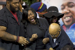 Sandra Sterling, the aunt of Alton Sterling, a black CD seller captured on video being shot and killed by a white police officer on July 5th, cries out after viewing his body at the F.G. Clark Activity Center in Baton Rouge, La. USA, Friday, July 15, 2016. Rev. Al Sharpton, who spoke at the roughly three hour service, called for more accountability for police officers who kill African-Americans and reeled off a list of high-profile police shootings that have angered many in the black community: {quote}We have an inferior judicial system that does not protect all of its citizens equally.{quote} (AP Photo/Max Becherer)