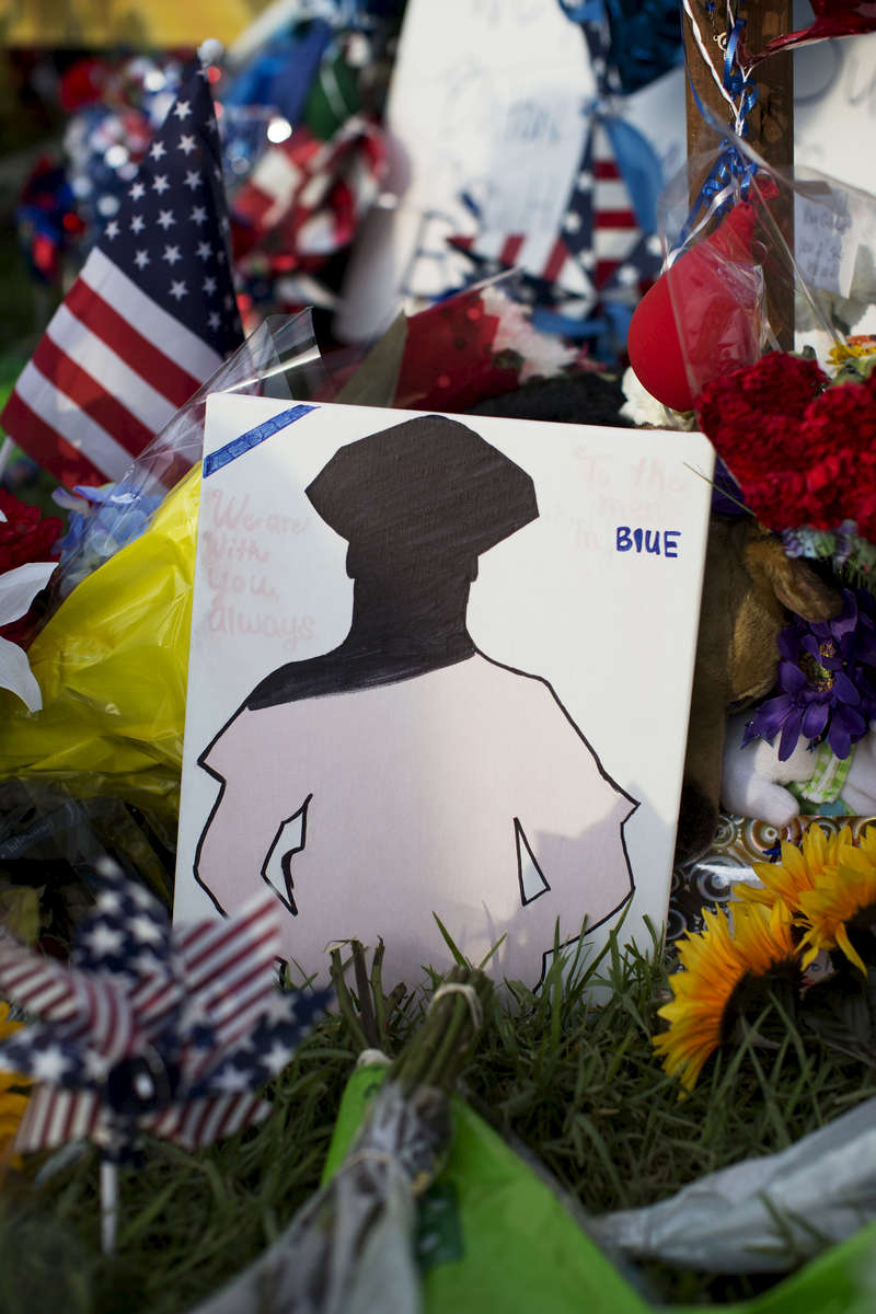 Hand written notes and mementos have been left at a makeshift memorial in front of the B-Quick convenience store after 3 law enforcement officers were killed by a gunman on Sunday in Baton Rouge, La. USA, Wednesday, July 20, 2016. According to authorities from the East Baton Parish Sheriff's Office the three deceased officers were identified as Baton Rouge Police officers Matthew Gerald, 41, of Denham Springs and Montrell Jackson, 32, and Brad Garafola, 45, of the East Baton Rouge Parish Sheriff's Office. (Max Becherer/Polaris)