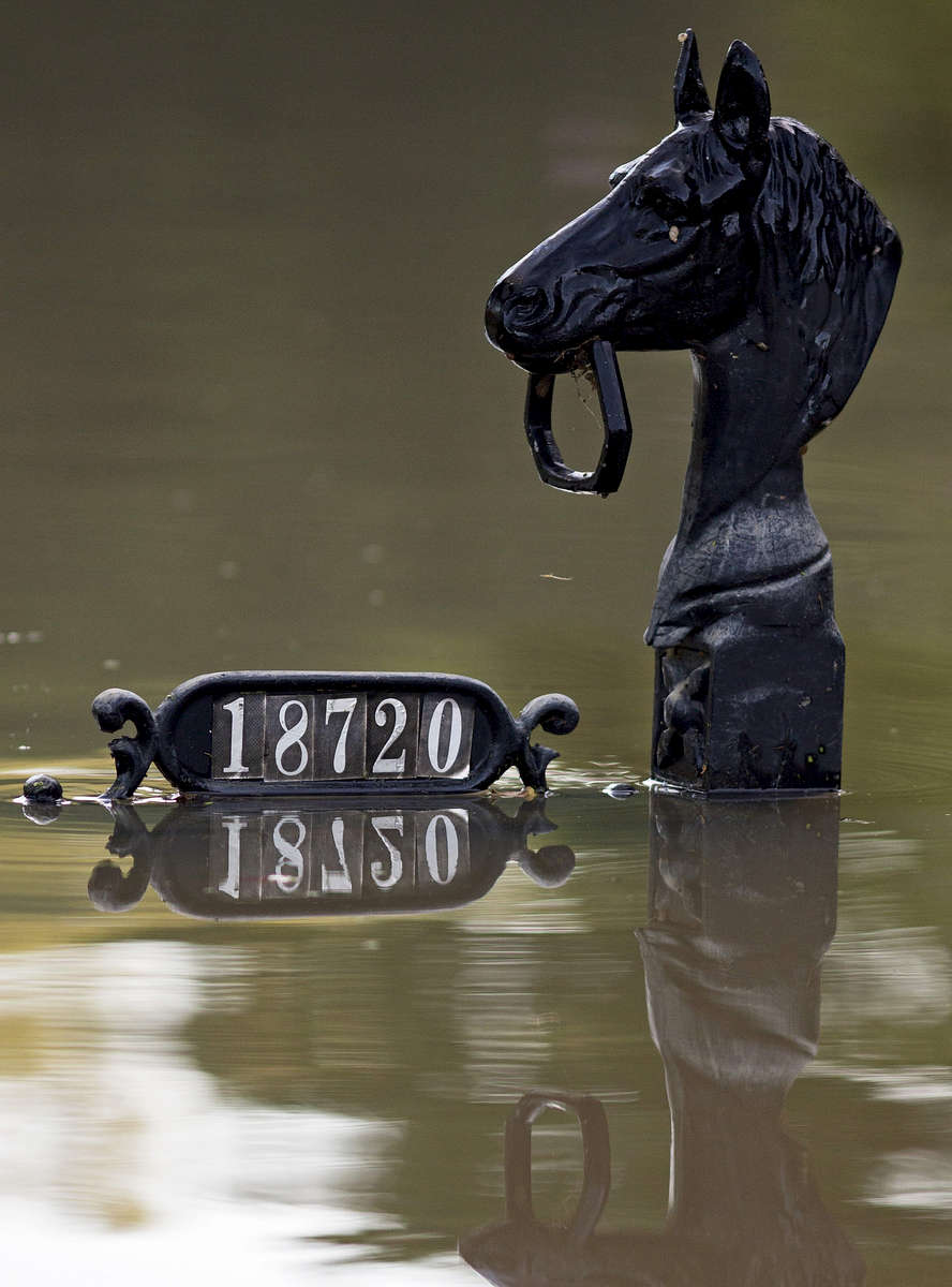 Mailbox posts are seen just above flood water in Prairieville, La. USA, Tuesday, Aug. 16, 2016. At least 40,000 homes were damaged in the historic Louisiana floods, according to Louisiana Gov. John Bel Edwards. (AP Photo/Max Becherer)