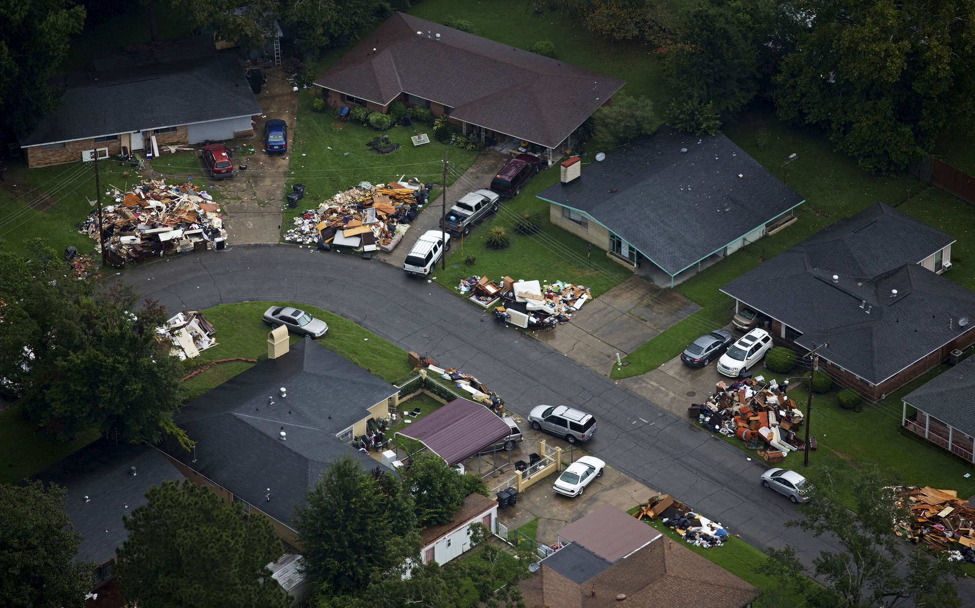 Debris from gutted homes can be seen in front of homes in this areal view of Baton Rouge, La. USA, Thursday, Aug. 25, 2016. President Obama signed a Louisiana disaster declaration on Aug. 14, making federal disaster funding available. (AP Photo/Max Becherer)