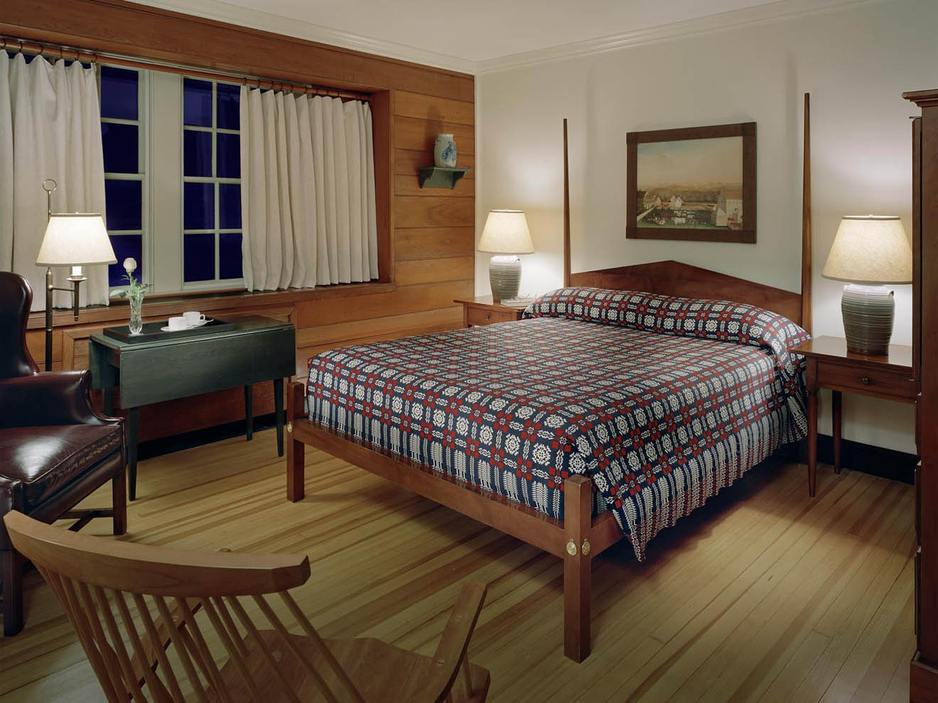 guestroom with wood floors and paneling