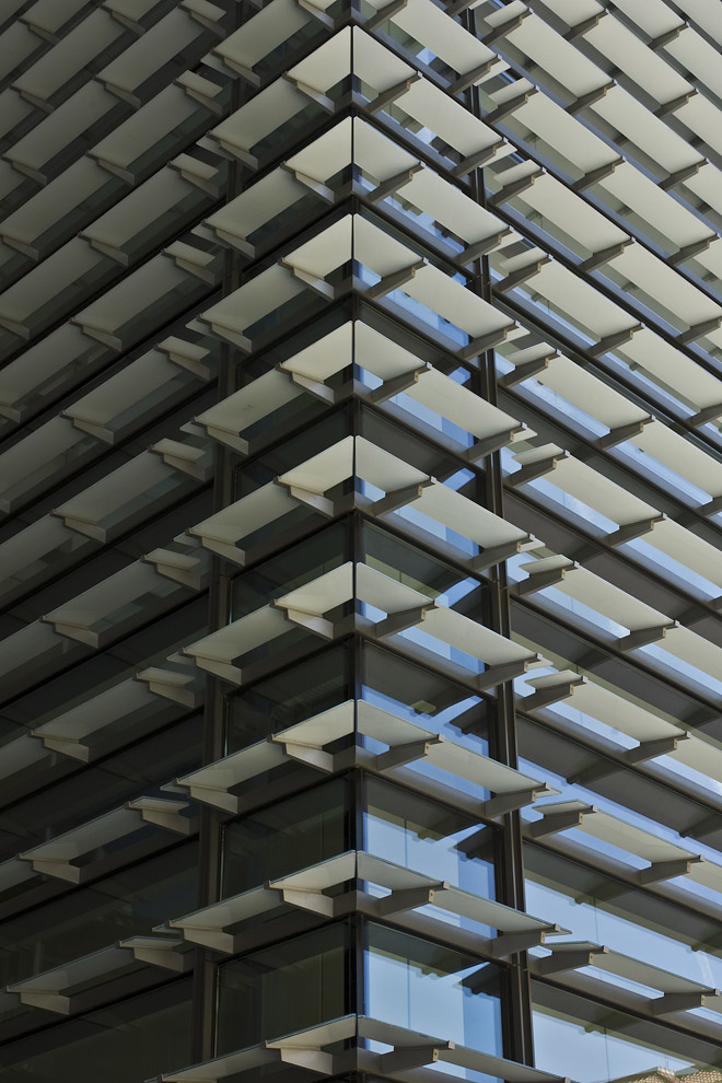 glass horizontal fins join at corner of building