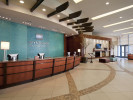 curved reception desk and floor patterns in hotel lobby