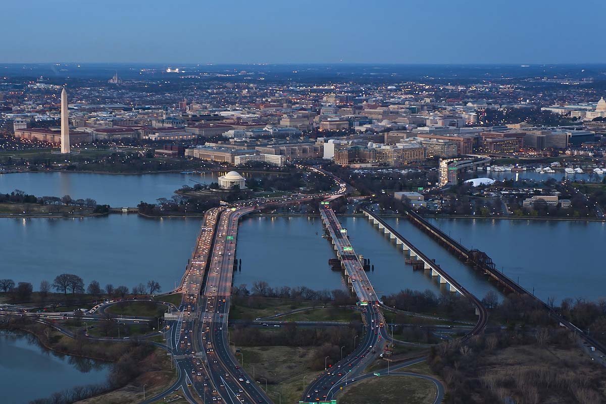Twilight aerial image of Washington DC from the Lincoln Memorial to the Capitol.